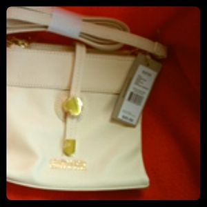 Purse cream color with gold accents